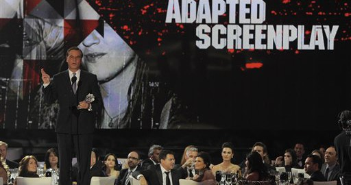 Writer Aaron Sorkin accepts the award for best adapted screenplay at the 16th Annual Critics' Choice Movie Awards on Friday, Jan. 14, 2011, in Los Angeles. (AP Photo/Chris Pizzello)
